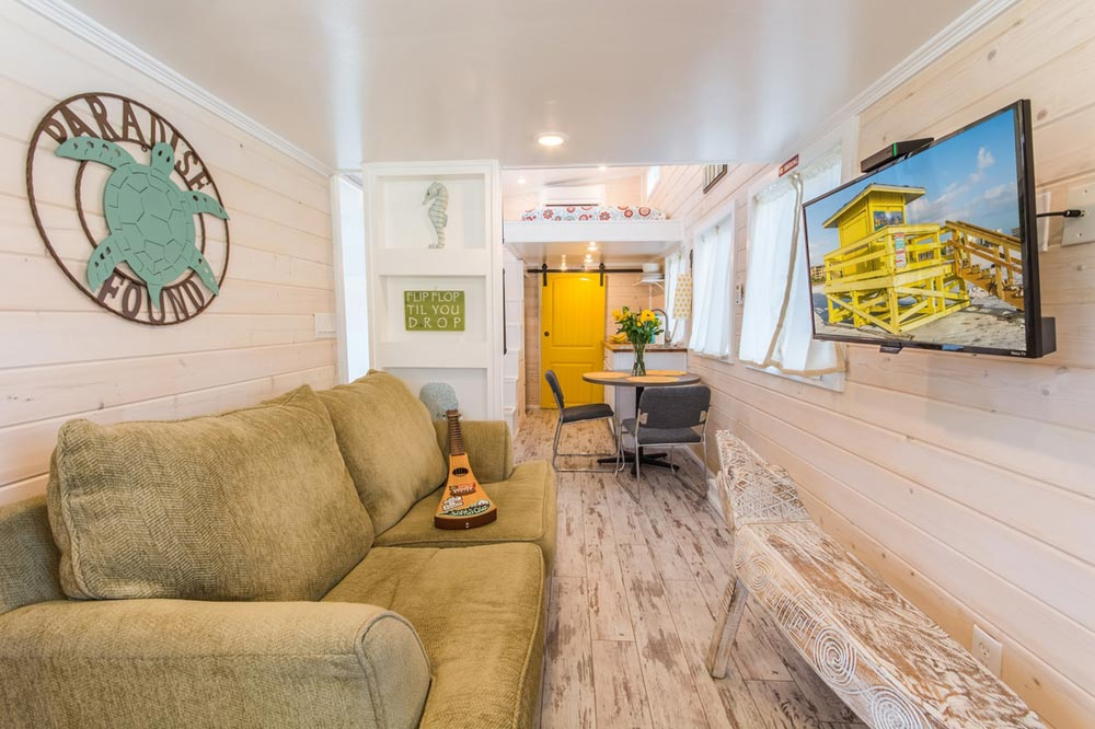 Living Room - Yellow Lifeguard by Upper Valley Tiny Homes