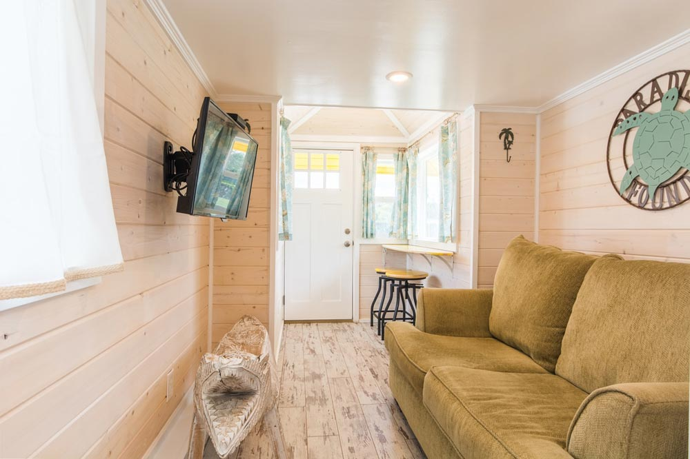 Couch & TV - Yellow Lifeguard by Upper Valley Tiny Homes