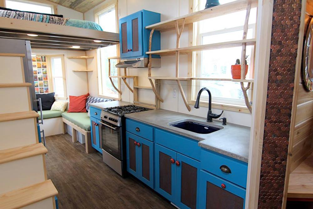 Kitchen with Concrete Counters - Custom Fabricated Siding - Elise & Clara's Tiny House by MitchCraft Tiny Homes
