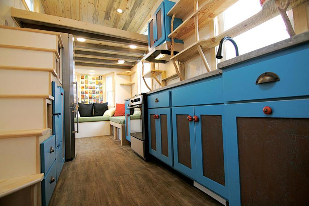 Blue Kitchen Cabinets - Custom Fabricated Siding - Elise & Clara's Tiny House by MitchCraft Tiny Homes