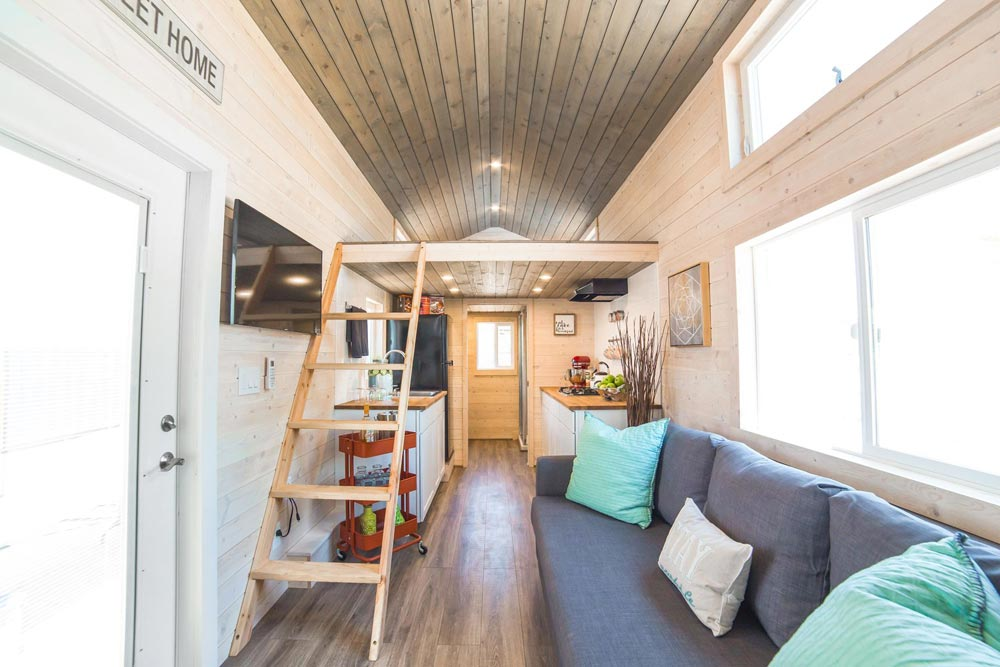 Living Room & Kitchen - Bunkhouse by Uncharted Tiny Homes