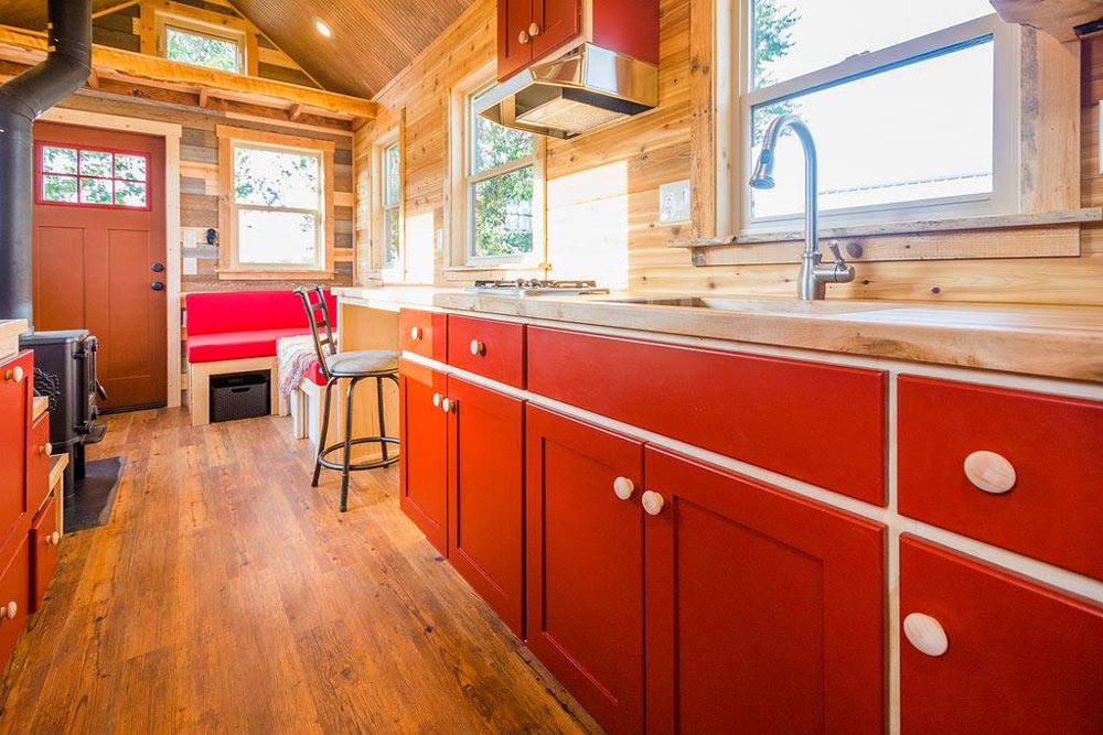 Red Cabinets - Davis' Off-Grid Tiny House by Mitchcraft Tiny Homes