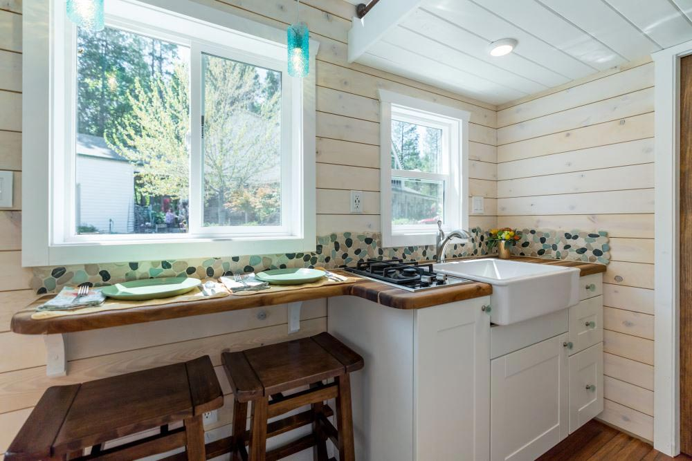 River Rock Backsplash - Roomy Retreat 24' by Sierra Tiny Houses
