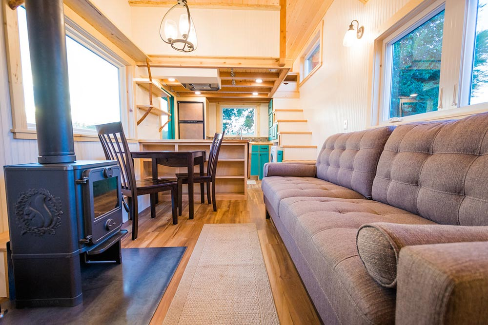 Couch & Stove - Laura's Tiny House by MitchCraft Tiny Homes
