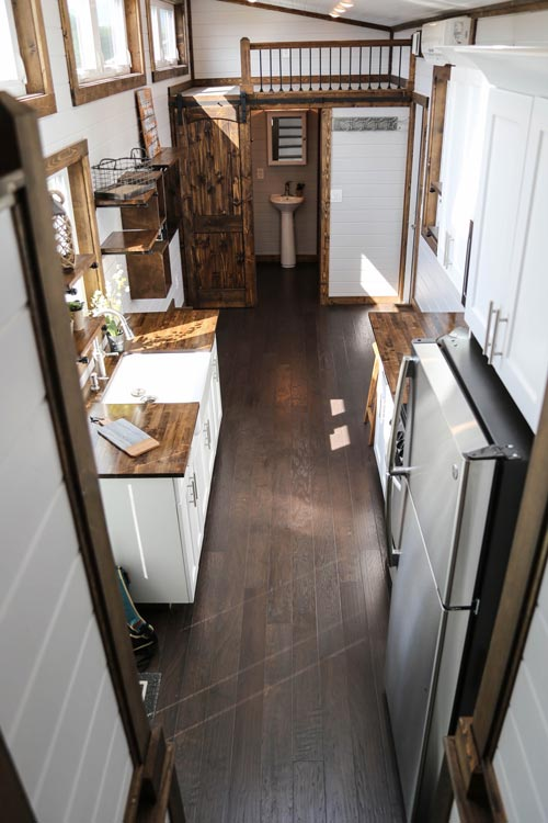 Dark Flooring - Mini Mansion by Tiny House Chattanooga