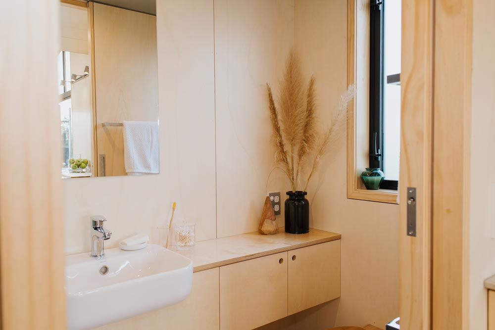 Bathroom Storage - First Light Tiny House by Build Tiny