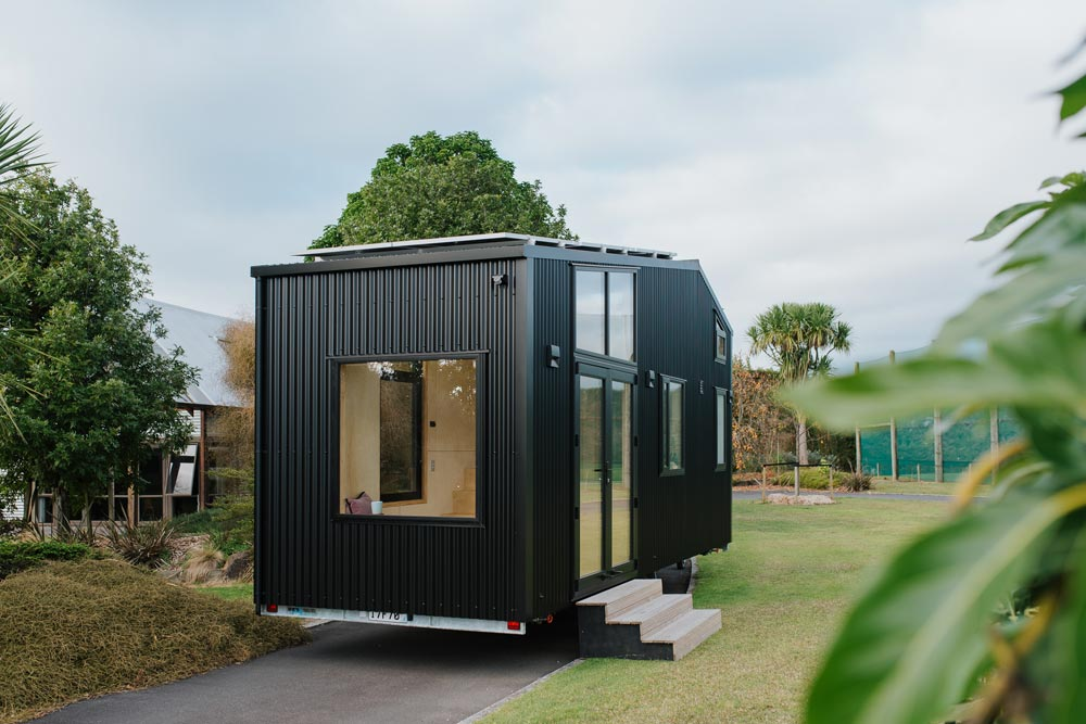 Black Corrugated Metal - First Light Tiny House by Build Tiny