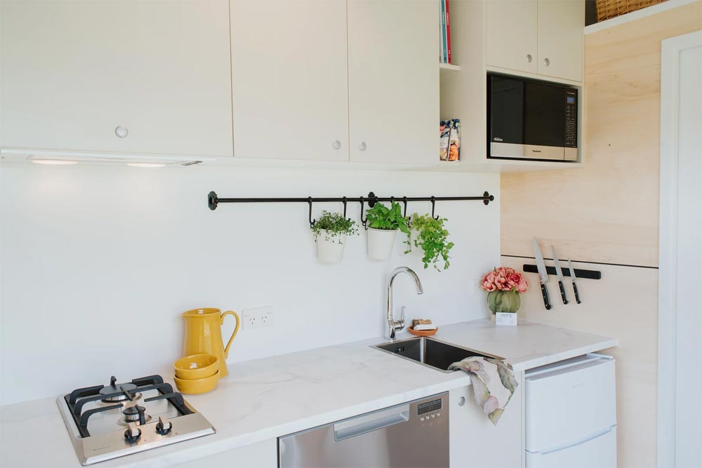 Minimalist Kitchen - Camper Tiny House by Build Tiny